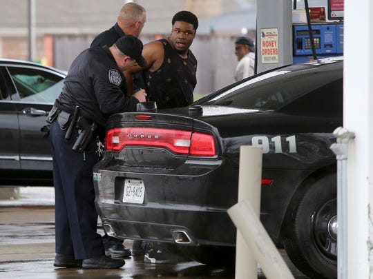 Jarvis Miller is taken into custody at the Highland Express gas station on Monday in Jackson. According to court documents, Miller is being charged with tampering with evidence after he threw a gun out the window of his vehicle. A police investigation found that Miller shot Gavin Hardin in self-defense.