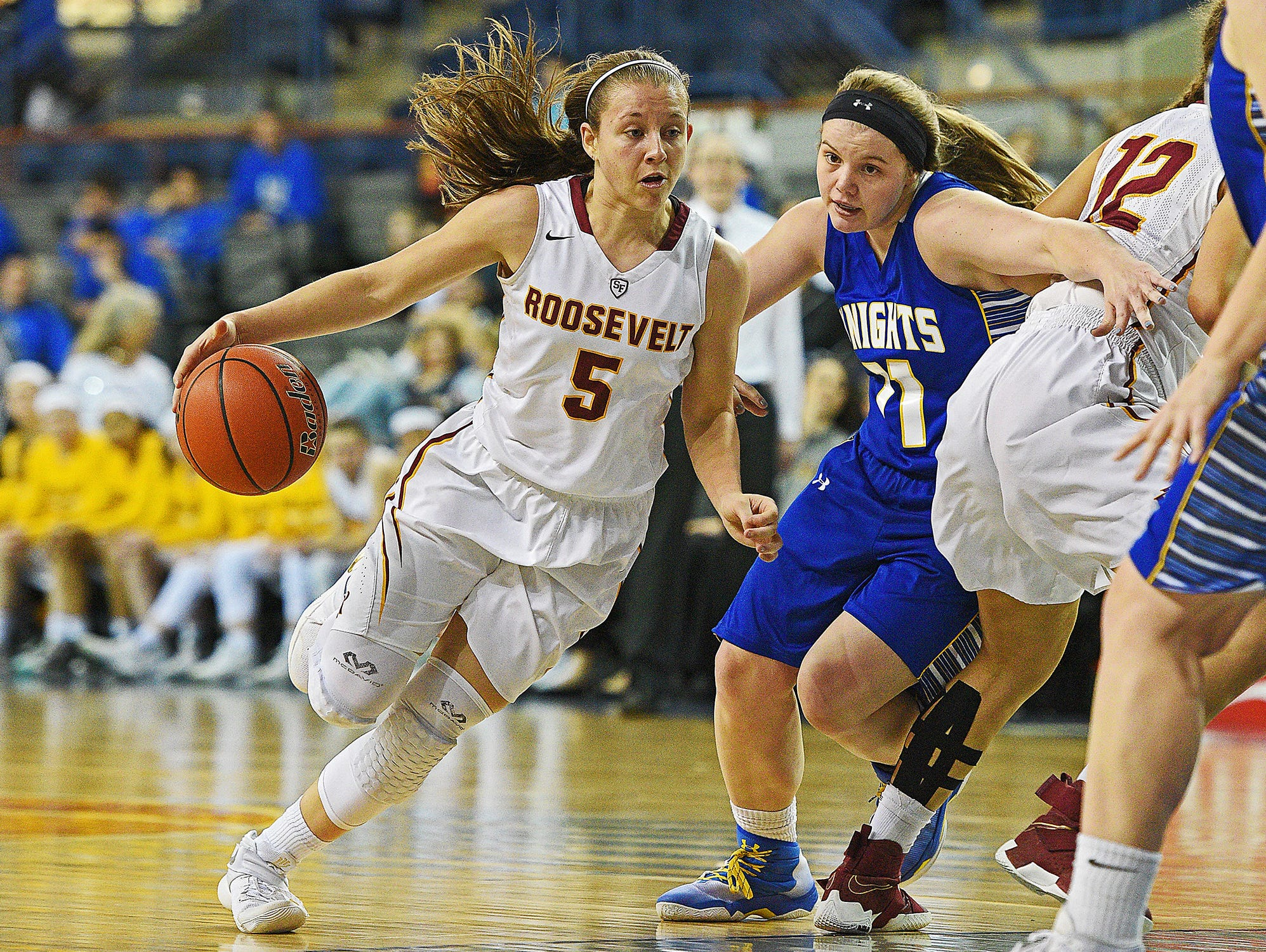 Roosevelt's Taylor Bonestroo (5) dribbles past O'Gorman's McKenzie Hermanson (11) during a 2017 SDHSAA Class AA State Girls Basketball quarterfinal game Thursday, March 16, 2017, at Rushmore Plaza Civic Center in Rapid City. O'Gorman beat Roosevelt 37-33.