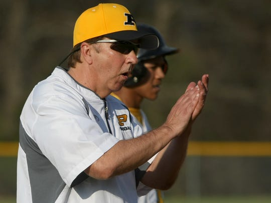 Peabody coach Todd Lumley encourages his batter during their game against Gibson County at Peabody High School in Trenton, Tenn., on Monday, March 20, 2017.