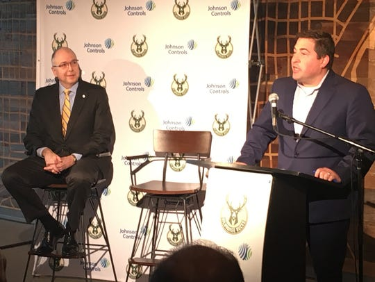 Milwaukee Bucks president Peter Feigin (right) and