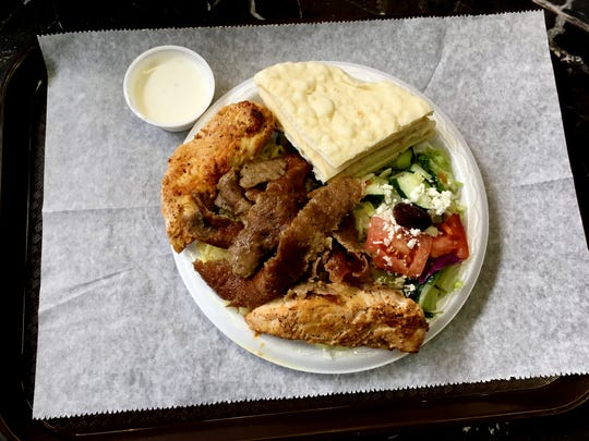 Chicago Gyro's combo plate with chicken, gyro, and Greek salad is $7.99, at Nashville Farmers Market.