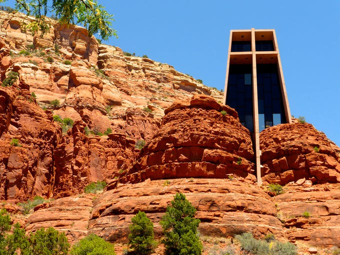 Chapel of the Holy Cross nestles against high sandstone