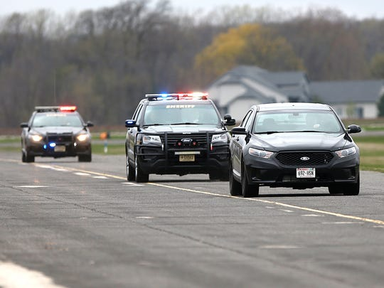 Fond du Lac Sheriff's deputies chase a car driven by another deputy as part of an annual training exercise at the Fond du Lac County Airport.