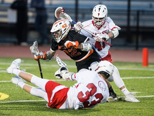 Palmyra's Nate Hawkins is hit by Cumberland Valley's
