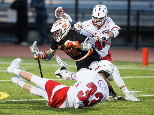 Palmyra's Nate Hawkins is hit by Cumberland Valley's Jarod Plessinger during Mid-Penn Conference championship game action on Thursday night.