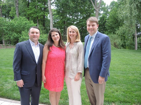 Chad and Brandi Ferrari, left, and Susan and E.W. Weathersby at the 2017 Swan Ball Underwriters Reception held at the home of Patti and Brian Smallwood.