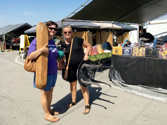 Stacey King and Amanda Davis go to the Flea Market almost every month. Here, at the May market they were thrilled to find wooden dough bowls for $20.