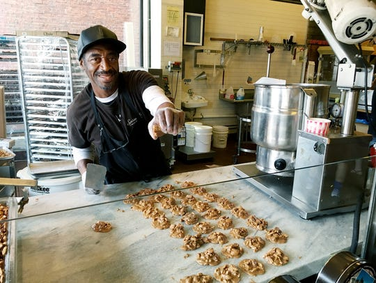 Maurice Dubose offers free praline samples to customers