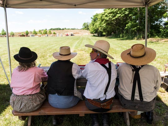 Participants in the long range shootout wait patiently for their turn to aim and fire at the targets during the National Congress of Old West Shootists event at the Westside SportsmenÕs Club in Evansville on Wednesday, June 7.