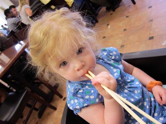Giulia Armato eats noodles at Pho Thanh