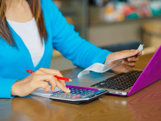 woman working with calculator,