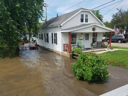 Rich Cassidy's home with a flooded basement and garage