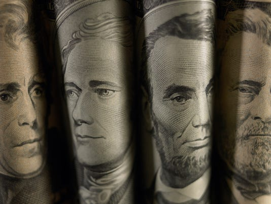 Folded bills showing faces of famous American Politicians