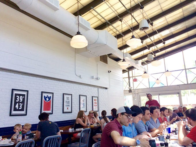 Dining in the sunroom at Biscuit Love's Hillsboro Village