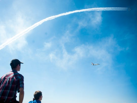 Onlookers watch the Thunderbirds perform during the