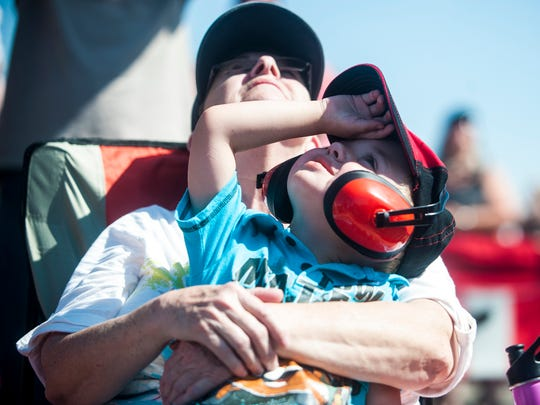 Aiden Smith, 3, watches the Thunderbirds with Patricia
