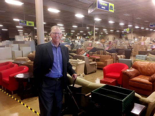 Habitat for Humanity CEO  Danny Herron shows off the furniture section of the new Habitat ReStore that is opening August 1.