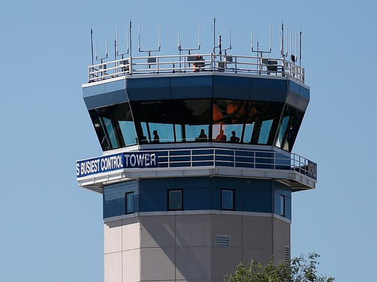 Air traffic controllers direct inbound and outgoing planes during EAA AirVenture 2017 at Wittman Regional Airport in Oshkosh.