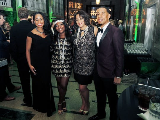 April Curry-R, left, Leigh Lovett and Erica and Darren Adderly at An Art Deco Affair, a fundraiser for and held at the Frist Center for the Visual Arts.