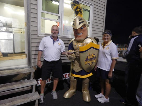 The Eastern York Golden Knight mascot, center, enjoys French fries with Mike Wanbaugh, left, and Sharon Stoner, right, of the Eastern York Rotary Club. The Eastern York nickname dates back to the school's first graduating class in 1959.