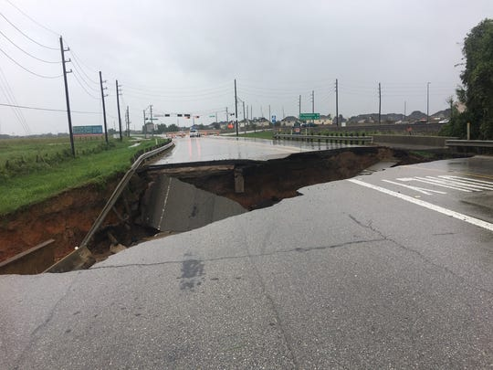 A sinkhole gobbled up a section of FM 762 Road in Rosenberg,