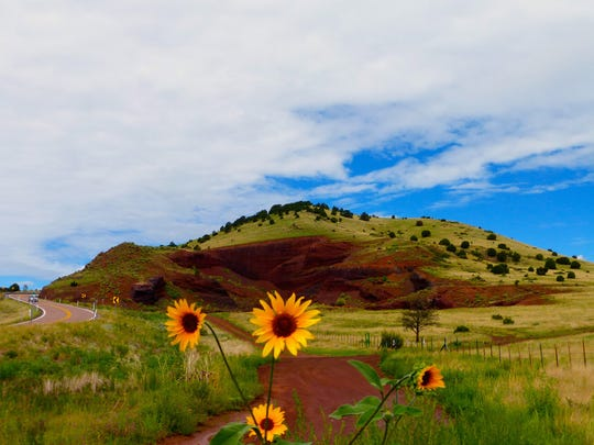 Old cinder cone volcanoes, like this one along State Route 260, are visible throughout the grassy basin that surrounds the towns of Springerville and Eagar.