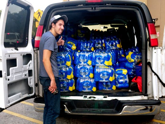 Jessie Pandorf of Smyrna shows a thumbs up in front of bottled waters loaded in van to donate to flood victims of Hurricane Harvey in the Beaumont, Port Arthur and Orange area of southeast Texas. Pandorf joined volunteers with Citizens Assisting Citizens in responding to the hurricane victims by passing out water, food and hygiene products.