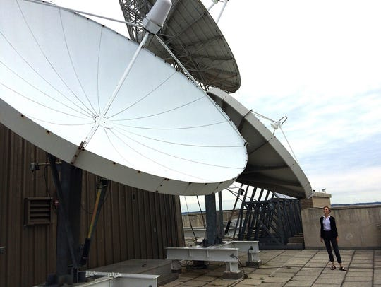 Seven huge satellite dishes are perched on top of the