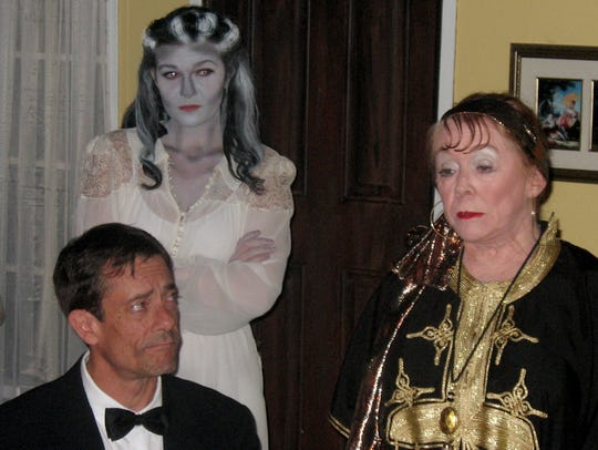 Elvira (Amanda Pease, top) appears at a seance conducted