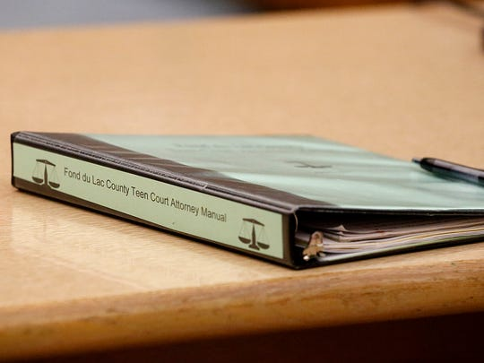 A teen court attorney manual sits on the prosecuting attorney's desk Wednesday during teen court at the City County Government Building in Fond du Lac. Doug Raflik/USA TODAY NETWORK-Wisconsin