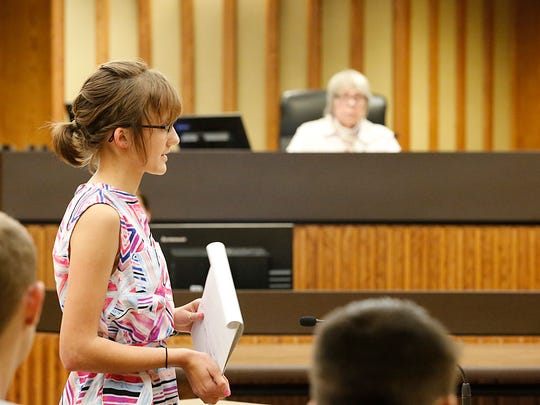 Ky Collins, a junior at Ripon High School, gives closing arguments as a prosecuting attorney Wednesday during teen court at the City County Government Building in Fond du Lac.