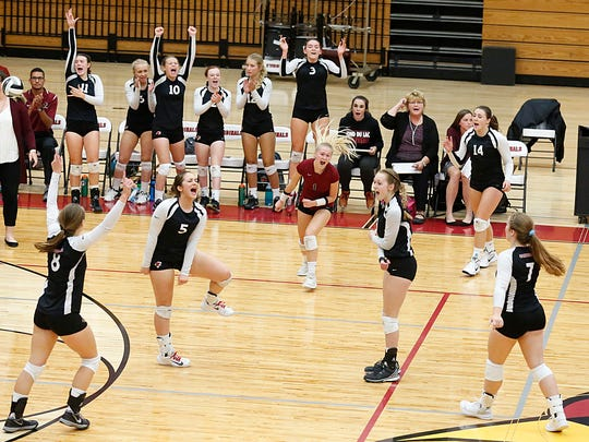 The Fond du Lac girls volleyball team celebrates a point against Kimberly during an Oct. 3 match.