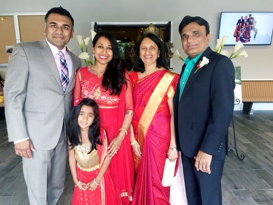 Heetesh Patel (right) with his daughter Anjali, wife Dimpal and parents  Dahyabhai and Kailas Patel.
