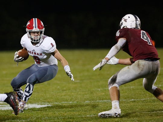 Neenah's Rayce Prosser (8) tries to elude the grasp of Fond du Lac's Carson Raddatz on Friday, Oct. 6 at Fruth Field in Fond du Lac.