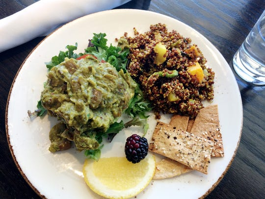 Curried avocado on tomato and greens, quinoa salad,