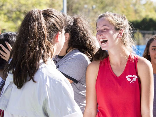 Vineland's Tess Fisher, right, shares a laugh with