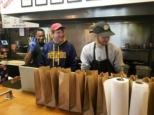 Gabby's owner Doug Havron shares a laugh with his cooking