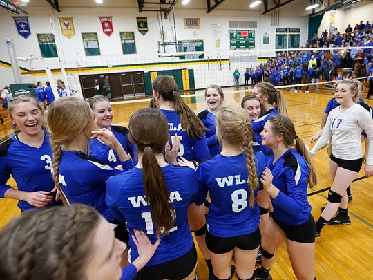 The Winnebago Lutheran Academy volleyball team celebrates after winning the Division 3 sectional match against St. Mary's Springs Academy 3-1 Thursday October 26, 2017 in Rosendale at Laconia High School. Doug Raflik/USA TODAY NETWORK-Wisconsin