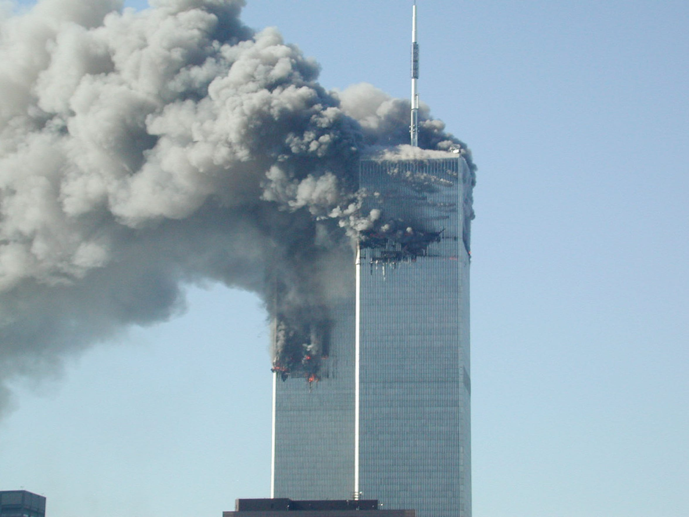 Smoke pours from the World Trade Center after being
