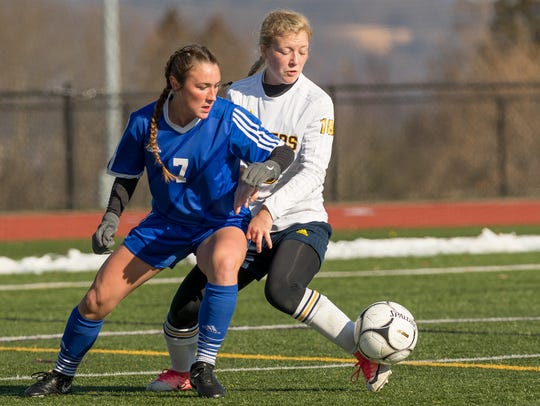 Pearl River's Kate McNally, left, tries to work the