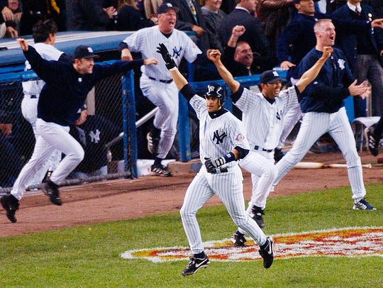 Yankees' Aaron Boone celebrates after hitting a solo home run in the 11th inning to beat the Boston Red Sox in Game 7 of the 2003 American League Championship Series.
