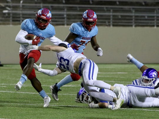 Hirschi's Daimarqua Foster breaks away from Decatur in a December playoff game.