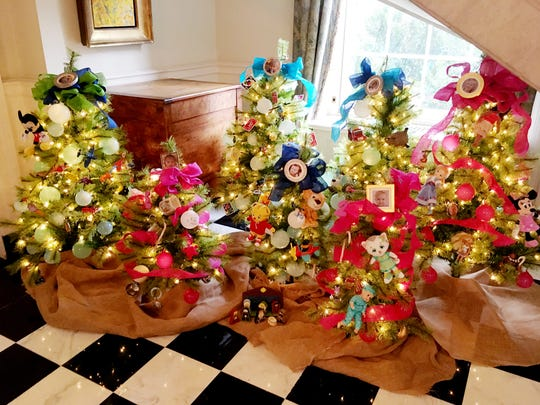First Lady Crissy Haslam decorates trees for each of their seven grandchildren.