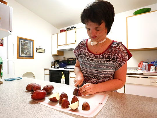 Sarah Freund helps her mom prepare dinner at their