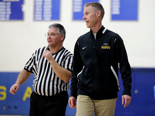 Waupun boys basketball coach Dan Domask expresses his displeasure with an official's call during a game against Campbellsport on Dec. 15.