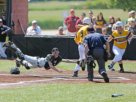 Waupun High School baseball's Bryce Burmania attempts