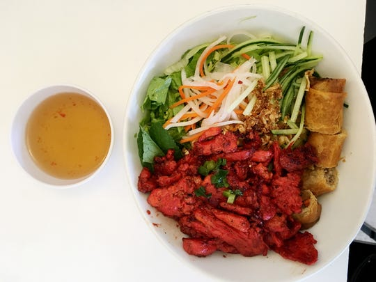 The pork with egg roll on vermicelli is a Ms. Cheap favorite for $6.95  at Kien Giang Vietnamese restaurant.