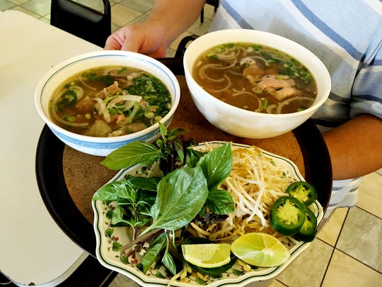 The Pho at Kien Giang is one of the most popular dishes. It is served with a plate of condiments to add to the soup.