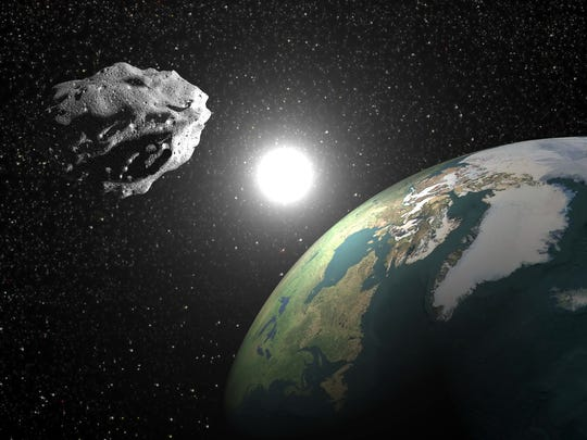 An illustration of an asteroid passing peaceably by Earth, as will happen Feb. 4.