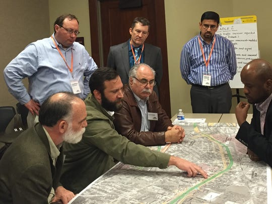 Members of the I-49 Community Working Group discuss plans Jan. 31, 2018.